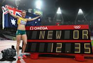 LONDON, ENGLAND - AUGUST 07: Sally Pearson of Australia poses next to the timing screen after setting a new Olympic record of 12.35 in the Women's 100m Hurdles Final on Day 11 of the London 2012 Olympic Games at Olympic Stadium on August 7, 2012 in London, England. (Photo by Michael Steele/Getty Images)
