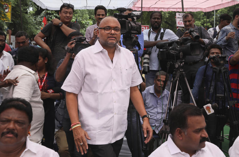 Karti Chidambaram, son of former Indian Finance Minister Palaniappan Chidambaram, arrives for an all party meeting to protest against the revocation of Kashmir's special constitutional status from Indian state of Jammu and Kashmir, in New Delhi, India, Thursday, Aug. 22, 2019. Karti Chidambaram has already been named as a defendant in the money-laundering case involving 3 billion rupees ($43 million). His father Palaniappan Chidambaram has already been arrested in the case. (AP Photo/Manish Swarup)