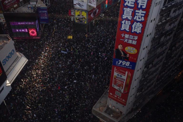 People crowd roads in the Causeway Bay area of Hong Kong as they take part in a pro-democracy rally