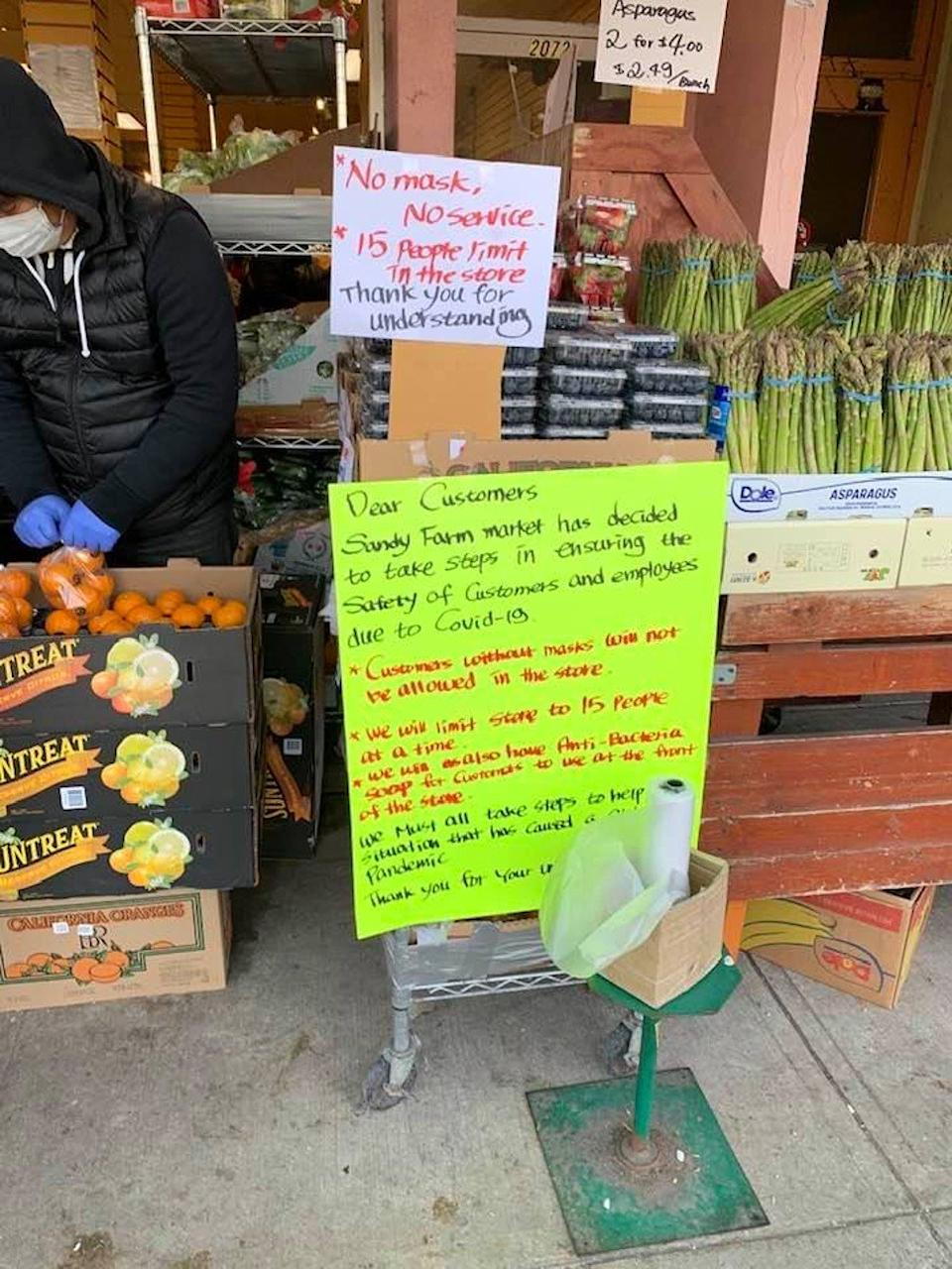 "Signs explain the ""no mask, no service"" policy of Vancouver's Sandy Farm Market grocery store in the neighbourhood of Kerrisdale. Photo: Caroline Wang"