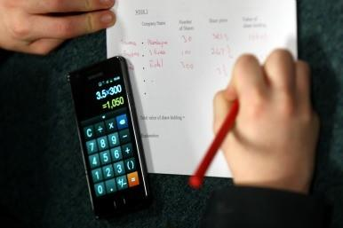 Person doing sums with calculator