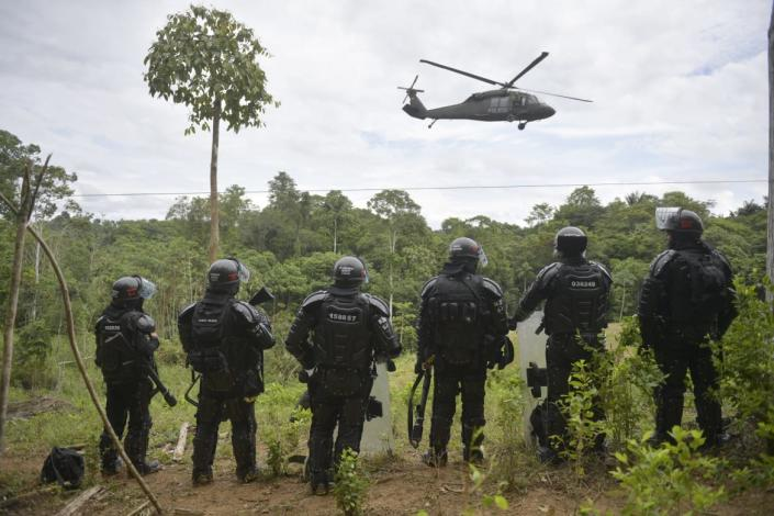 "<div class=""inline-image__caption""> <p>Colombian police take over a coca field on Feb. 26, 2020.</p> </div> <div class=""inline-image__credit""> RAUL ARBOLEDA/AFP via Getty Images </div>"