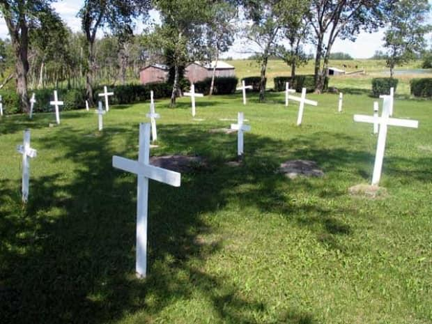 Crosses were raised by former staff and students of Elkhorn Residential School at a reunion in 1990, in a cemetery where several children who were forced to attend the school are buried.