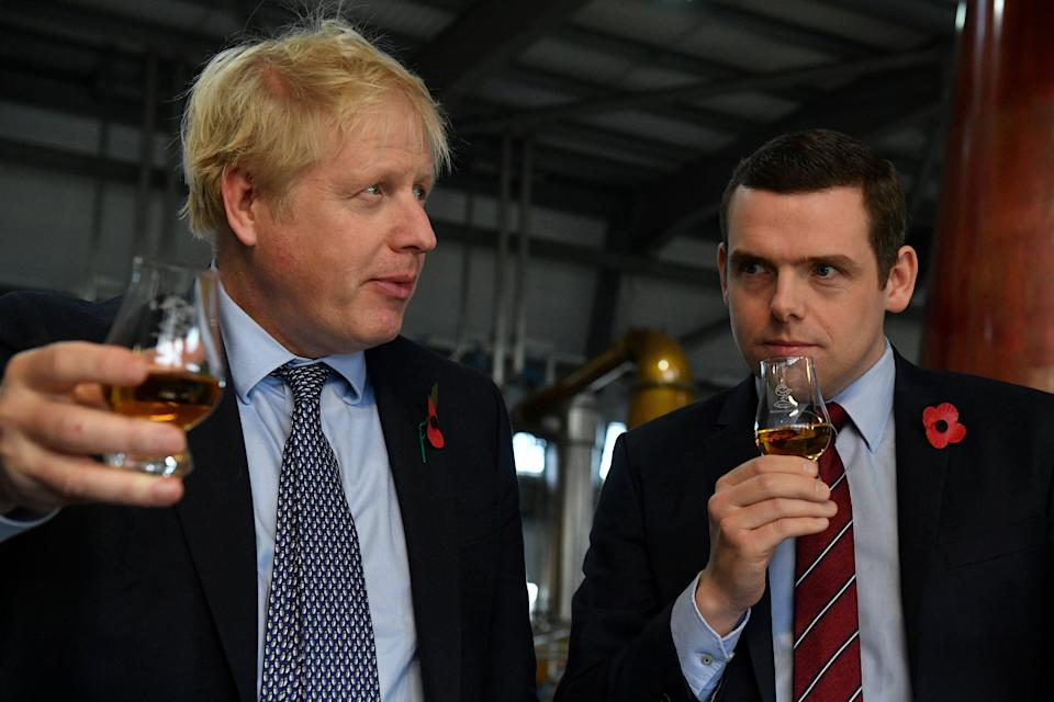 <p>Boris Johnson and the Scottish Conservative leader, Douglas Ross, during the 2019 general election campaign</p> (REUTERS)