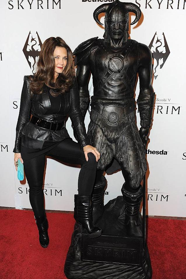 """Former """"Wonder Woman"""" Lynda Carter loaned her voice to the game, and further showed her love for the project by posing with one of its characters at the launch. (11/8/2011)"""