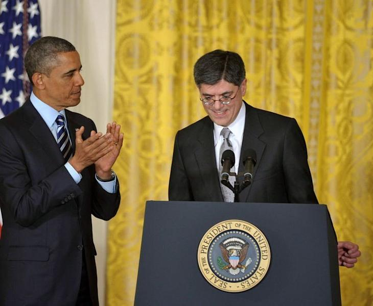 US President Barack Obama applauds after he announced his choice of White House Chief of Staff Jack Lew (R) as the next Treasury Secretary in the East Room of the White House on January 10, 2013 in Washington, DC. Lew, 57, is a classic Washington insider, with multiple tours of duty across the government, including two as budget director