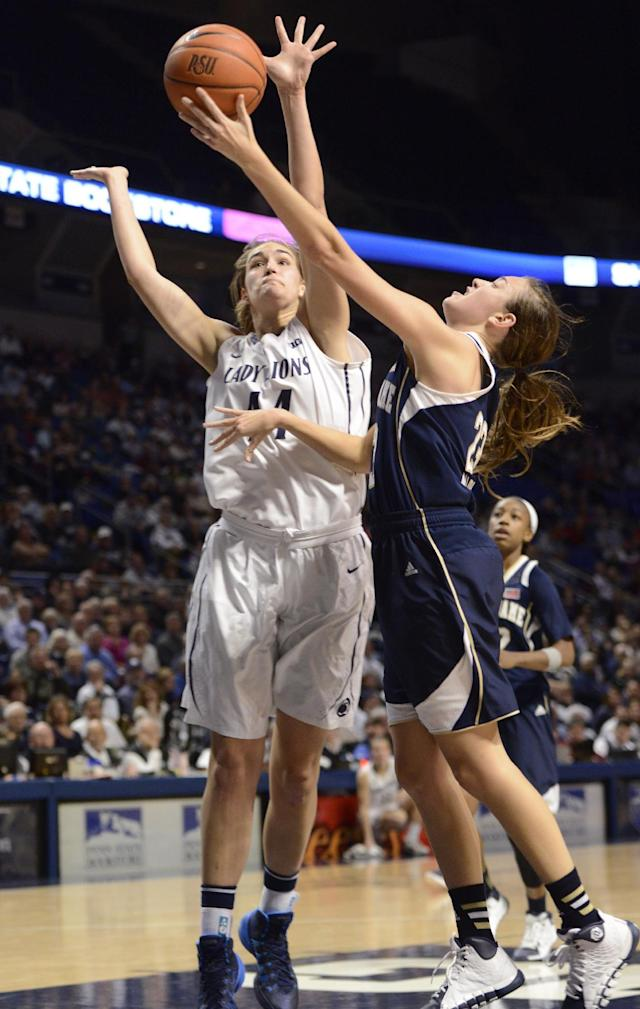 Penn State's Tori Waldner (44), left, tries to block a shot by Notre Dame guard Michaela Mabrey (23) in the second half of an NCAA college basketball game on Wednesday, Dec. 4, 2013, in State College, Pa. Notre Dame defeated Penn State 77-67. (AP Photo/John Beale)