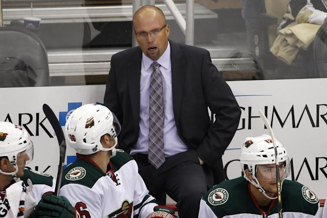 Minnesota Wild head coach Mike Yeo talks to Jason Zucker (16) in the first period of an NHL preseason hockey game against the Pittsburgh Penguins in Pittsburgh, Thursday, Sept. 25, 2014. (AP Photo/Gene J. Puskar)