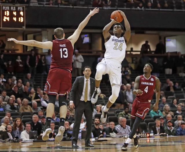 Vanderbilt forward Aaron Nesmith (24) takes a shot at the buzzer at the end of the second half as South Carolina's Felipe Haase (13) and Tre Campbell (4) defend in an NCAA college basketball game Wednesday, Jan. 16, 2019, in Nashville, Tenn. Nesmith missed his attempt to tie the game, and South Carolina won 74-71. (AP Photo/Mark Humphrey)
