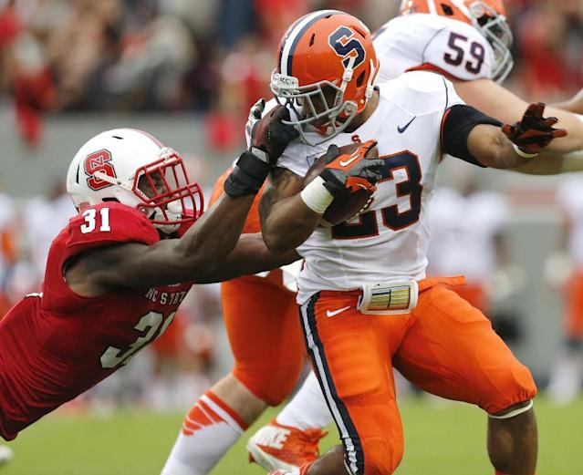 North Carolina State linebacker D.J. Green (31) is called for a face mask penalty on Syracuse running back Prince-Tyson Gulley (23) during the first half of an NCAA college football game Saturday, Oct. 12, 2013, at Carter-Finley Stadium in Raleigh, N.C. (AP Photo/The News & Observer, Ethan Hyman)