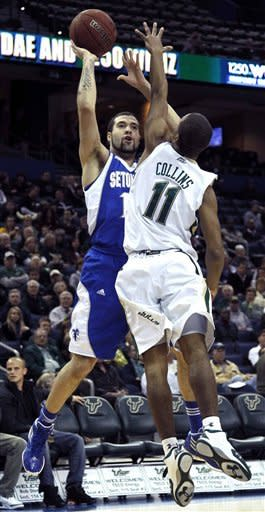 Seton Hall guard Freddie Wilson, left, shoots over South Florida guard Anthony Collins during the first half of an NCAA college basketball game, Friday Jan. 13, 2012, in Tampa, Fla. (AP Photo/Chris O'Meara)