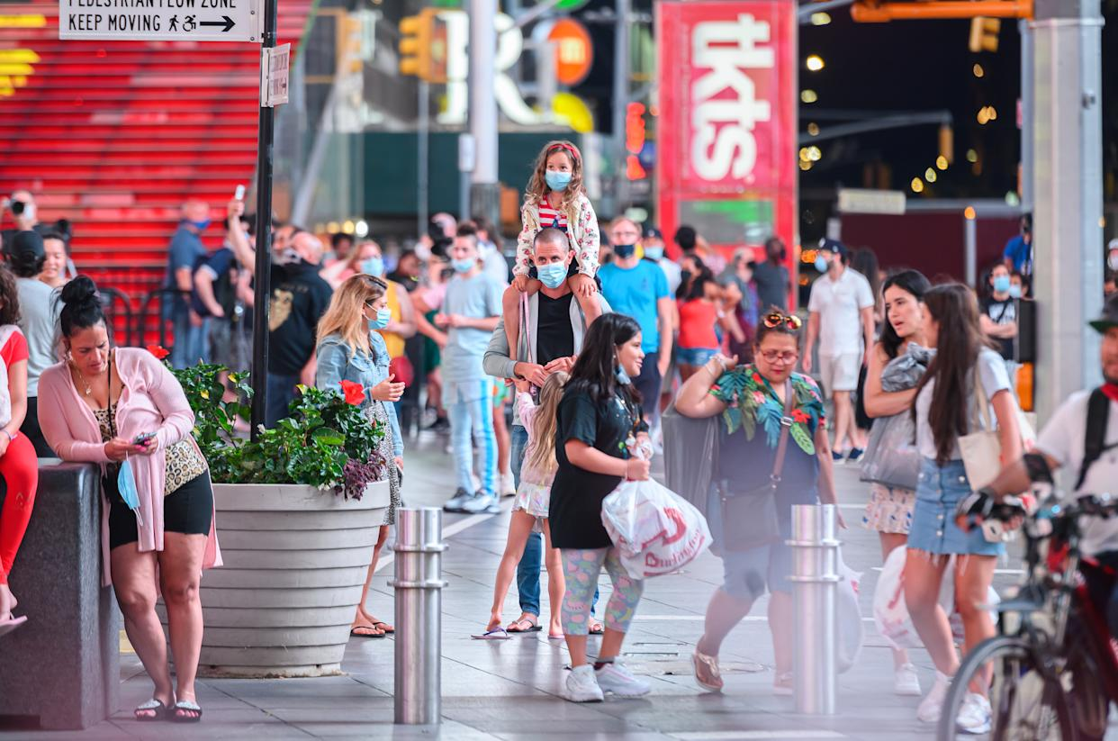 NEW YORK, NEW YORK - JULY 01: People fill Times Square as New York City moves into Phase 2 of re-opening following restrictions imposed to curb the coronavirus pandemic on July 1, 2020. Phase 2 permits the reopening of offices, in-store retail, outdoor dining, barbers and beauty parlors and numerous other businesses. Phase 2 is the second of four phased stages designated by the state. (Photo by Noam Galai/Getty Images)