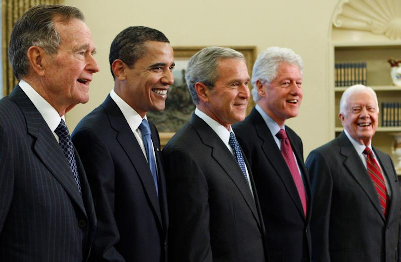 In this Jan. 7, 2009 photo, President George W. Bush, center, poses with President-elect Barack Obama, second left, and former presidents, George H.W. Bush, left, Bill Clinton, second right, and Jimmy Carter, right, in the Oval Office of the White House in Washington.