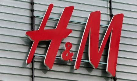 FILE PICTURE: The logo of Swedish fashion retail group H&M is seen at a building in Dietlikon, Switzerland October 11, 2016.  REUTERS/Arnd Wiegmann