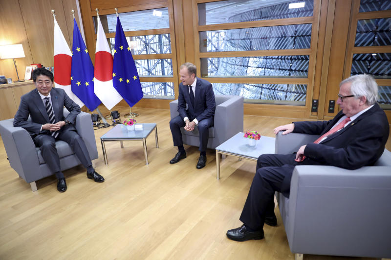 Japan's Prime Minister Shinzo Abe, left, meets with European Commission President Jean-Claude Juncker, right, and European Council President Donald Tusk, center, during an EU-Japan summit at the European Council building in Brussels, Thursday, April 25, 2019. Japanese Prime Minister Shinzo Abe and top EU officials are discussing trade, bilateral ties and North Korea. (AP Photo/Francisco Seco, Pool)