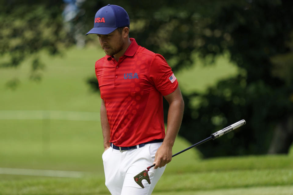 Xander Shauffele of United States walks on 17th green during the first round of the men's golf event at the 2020 Summer Olympics, Friday, July 30, 2021, at the Kasumigaseki Country Club in Kawagoe, Japan, (AP Photo/Matt York)