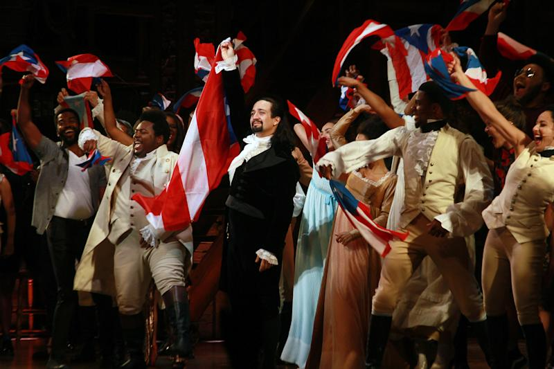 "SAN JUAN, PUERTO RICO - JANUARY 27: Lin-Manuel Miranda and the cast of ""Hamilton"" say goodbye to the audience at the end of the performance during the closing night of ""Hamilton"" at Centro de Bellas Artes on January 27, 2019 in San Juan, Puerto Rico. (Photo by Gladys Vega/Getty Images)"