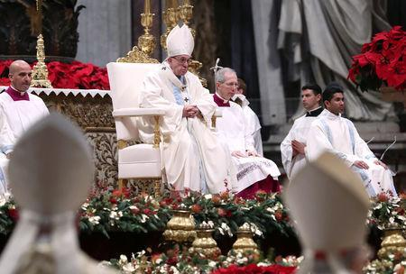 Pope Francis leads a mass to mark the World Day of Peace in Saint Peter's Basilica at the Vatican, January 1, 2019. REUTERS/Tony Gentile