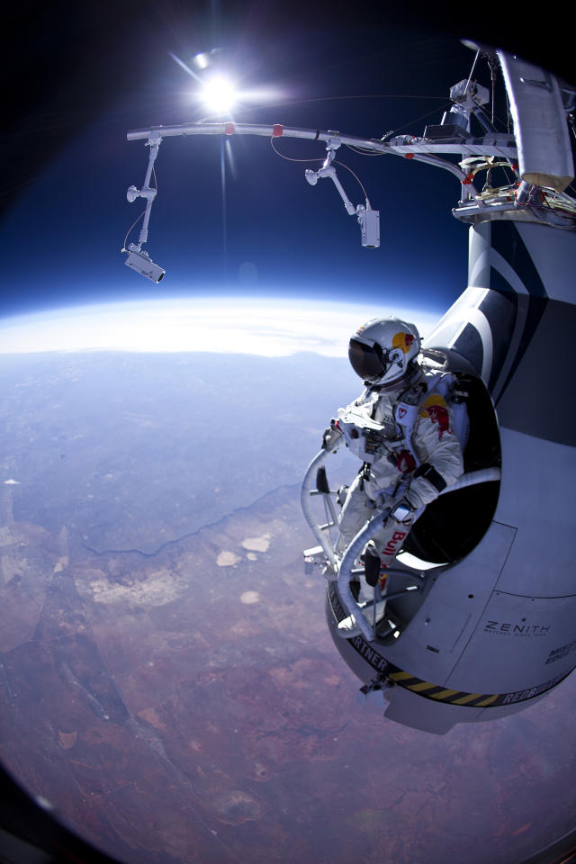 "FILE - In this Thursday, March 15, 2012 photo provided by Red Bull Stratos, Felix Baumgartner prepares to jump during the first manned test flight for Red Bull Stratos over Roswell, N.M. On Wednesday, July 25, 2012, the 43-year-old Austrian plunged to Earth from an altitude of more than 18 miles landing safely near Roswell, N.M. It's was second stratospheric leap for ""Fearless Felix."" He's aiming for a record-breaking jump from 125,000 feet, or 23 miles, in another month. He hopes to go supersonic, breaking the speed of sound with just his body. (AP Photo/Red Bull Stratos, Jay Nemeth)"