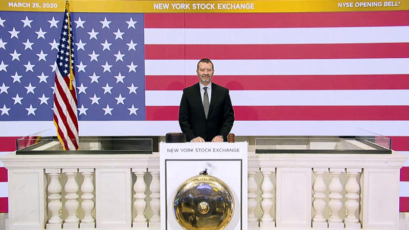 In this photo taken from video provided by the New York Stock Exchange, Director of Facilities & Building Operations James Katsarelis rings the opening bell at the NYSE,  on Wednesday, March 25, 2020. Stocks are wobbling in tentative trading Wednesday as a historic, worldwide rally downshifts dramatically after just a day.  (New York Stock Exchange via AP)