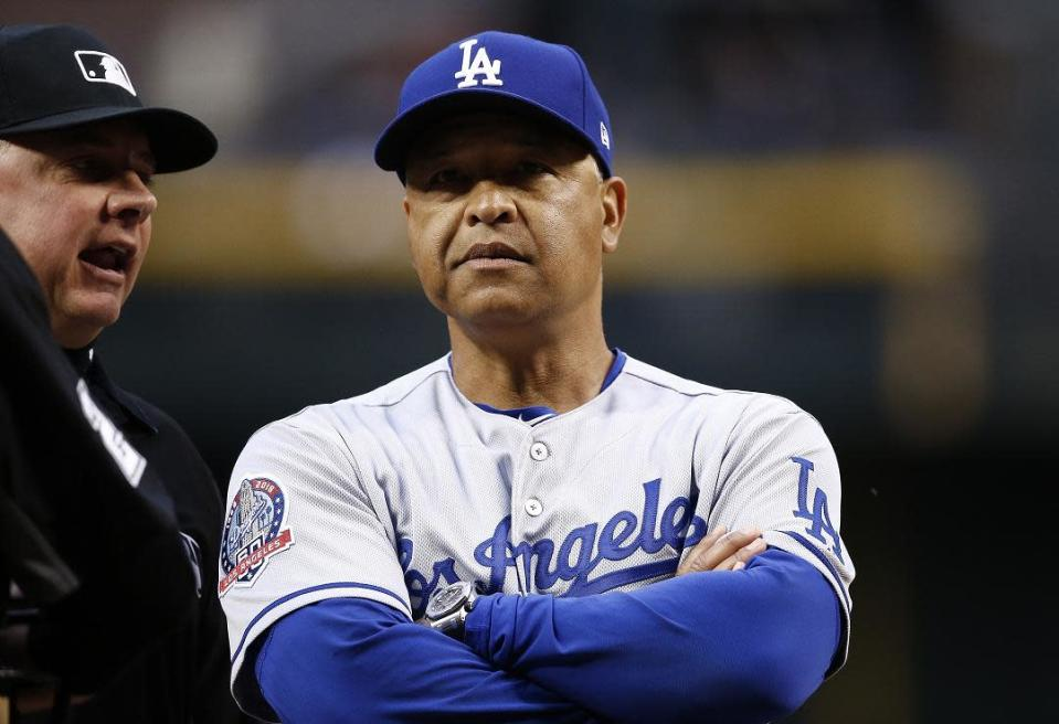 Dodgers manager Dave Roberts is searching for answers to his team's stunningly slow start. (AP)