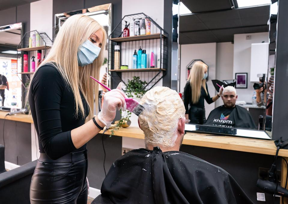 Bart Horgan receives a free 'Phil Foden' hair cut from Maisy Salisbury-Taylor at Simon Townley hair salon in Burnley, Lancashire, who are offering free hair cuts in the styles of England players, ahead of the Euro 2020 final (PA Wire)