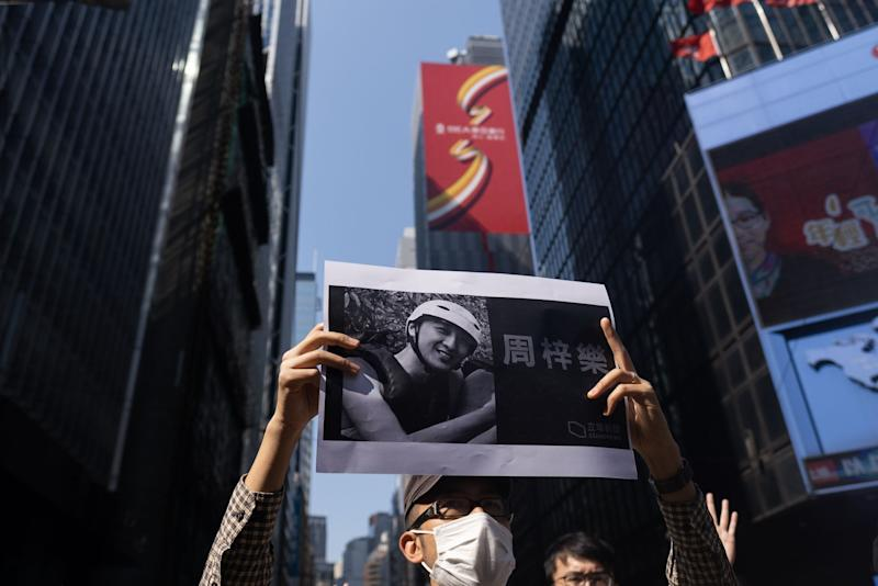 Hong Kong Police Fire Warning Shot After Death Fuels Clashes