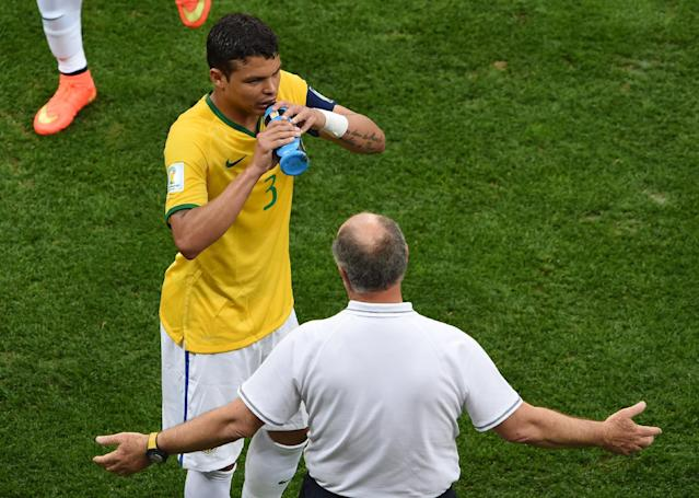 Brazil's captain Thiago Silva (L) drinks water as he speaks with Brazil's coach Luiz Felipe Scolari during the third place play-off match against the Netherlands during the 2014 FIFA World Cup at the National Stadium in Brasilia on July 12, 2014 (AFP Photo/Evaristo Sa)