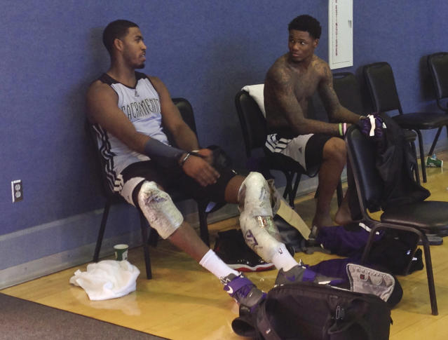 Sacramento Kings forward Jason Thompson, left, speaks with rookie guard Ben McLemore after the NBA basketball team's first practice of training camp, Tuesday, Oct. 1, 2013, in Santa Barbara, Calif. The Kings are hoping their successful summer leads to more victories this season with a new coaching staff, front office and ownership group. (AP Photo/Greg Beacham)