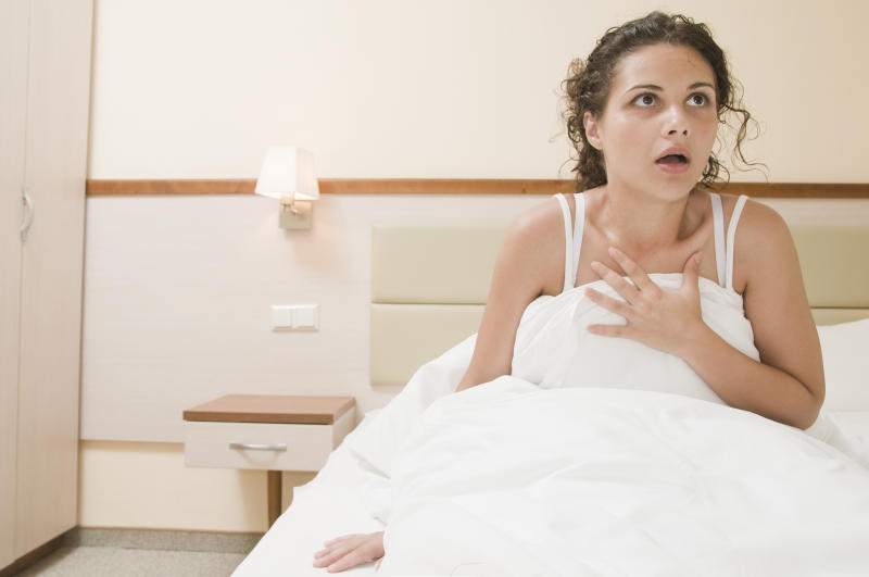 Woman waking up from a bad dream