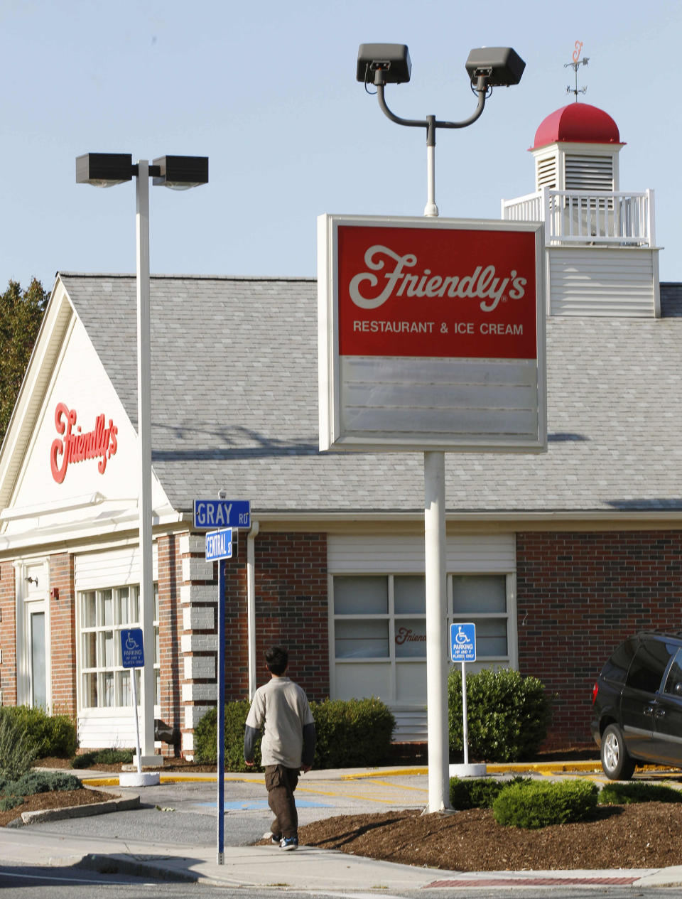 A boy walks past the Friendly's restaurant in Foxborough, Mass., Wednesday, Oct. 5, 2011.  The parent of the Massachusetts-based Friendly's restaurant chain filed for Chapter 11 bankruptcy  protection on Wednesday and said that it has already closed 63 of its stores. Each store employed about 20 people, so about 1,260 jobs were lost. (AP Photo/Charles Krupa)