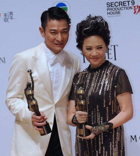 "Hong Kong actors Deanie Ip (R) and Andy Lau on April 15 after winning awards for their roles in the film ""A Simple Life"" at the 31st Hong Kong Film Awards. The Hong Kong Motion Pictures Industry Association accused YouTube of ""severe"" copyright infringements after clips of the film, which is still showing in Hong Kong cinemas, were found the video-sharing website"