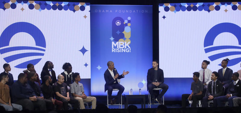 Former President Barack Obama and NBA star Steph Curry speak at a My Brother's Keeper event in Oakland, California, on Tuesday.