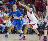 Kentucky guard Makayla Epps, left, looks to drive to the basket as Arkansas guard Kelsey Brooks, right, defends during the first half of an NCAA college basketball game Thursday, Feb. 26, 2015, in Fayetteville, Ark. Kentucky won 56-51. (AP Photo/Gareth Patterson)