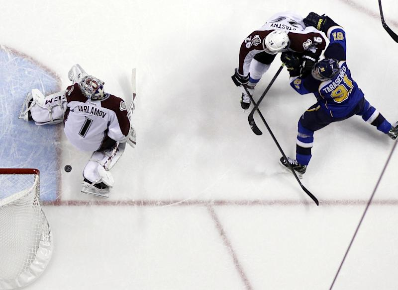 A shot by St. Louis Blues' Vladimir Tarasenko (91), of Russia, slips past Colorado Avalanche goalie Semyon Varlamov, left, also of Russia, as the Avalanche's Paul Stastny (26) watches during the second period of an NHL hockey game Thursday, Nov. 14, 2013, in St. Louis. (AP Photo/Jeff Roberson)