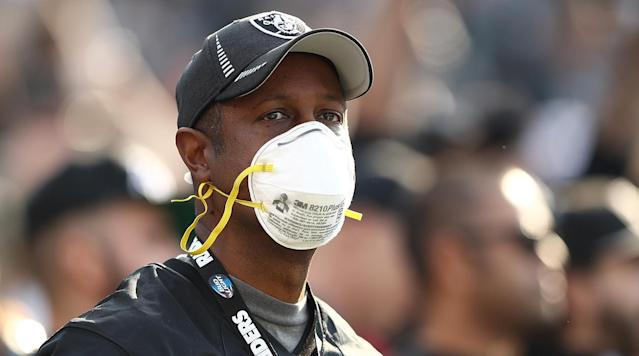 The Raiders handed out masks to those who wanted them during Sunday's game against the Chargers as deadly wildfires raged just a few hours north of the team's Oakland-Alameda County Coliseum.