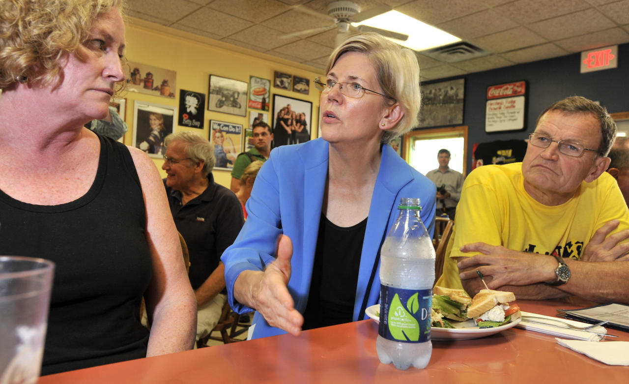 Harvard Law professor and consumer advocate, Democrat Elizabeth Warren, center, talks with supporters, Anne Manning, of Ashland, left, and former State Rep.John Stasik of Framingham, right, at the J & M Diner in Framingham, Mass., Wednesday, Sept. 14, 2011, during her first day of campaigning for a shot at challenging incumbent Republican Sen. Scott Brown in 2012 for his U. S. Senate seat. (AP Photo/Josh Reynolds)