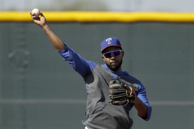 Texas Rangers' Elvis Andrus throws during spring training baseball practice Monday, Feb. 17, 2020, in Surprise, Ariz. (AP Photo/Charlie Riedel)
