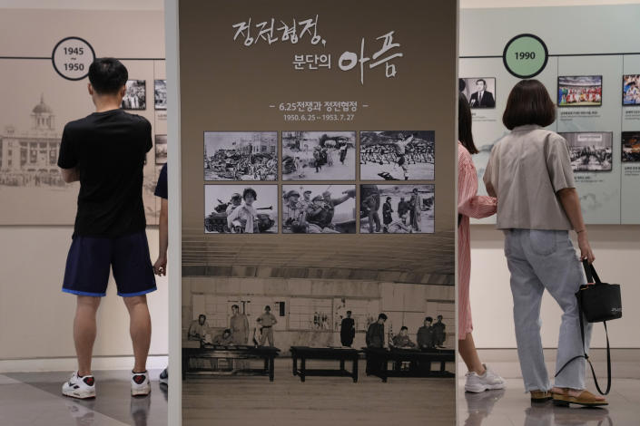 """Photos taken during the Korean War are displayed at the Unification Observation Post in Paju, South Korea, near the border with North Korea, Sunday, Sept. 26, 2021. The powerful sister of North Korean leader Kim Jong Un said Saturday that her country will take steps to repair ties with South Korea, and may even discuss another summit between their leaders, if the South drops what she described as hostility and double standards. Korean letters read: """"Armistice agreement and the pain of division."""" (AP Photo/Ahn Young-joon)"""
