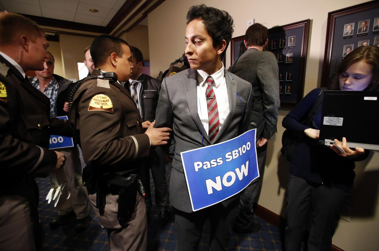 LGBT rights activist are detained by members of the Utah Highway Patrol after blocking a Senate committee hearing room at the Utah State Capitol, February 10, 2014, in Salt Lake City, Utah. LGBT rights activist are demanding the Legislature consider an anti-discrimination bill, Senate Bill 100, which the Senate has declined to do so. REUTERS/Jim Urquhart (UNITED STATES - Tags: POLITICS CRIME LAW)