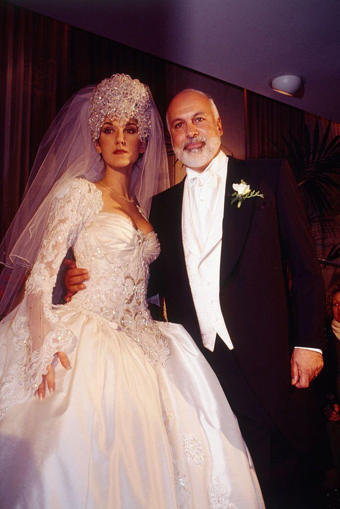 <p>For her wedding to René Angélil, Dion wore a gorgeous ball gown with intricate beading and an elaborate headpiece.</p>