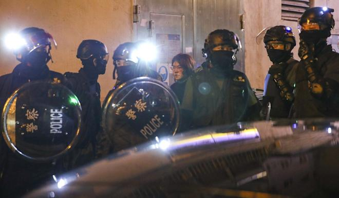 Riot police make arrests in Tai Po following scuffles with anti-government protesters. Photo: Winson Wong