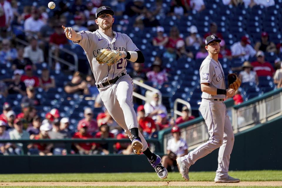 Colorado Rockies shortstop Trevor Story (27) throws to first base during the seventh inning of a baseball game against the Washington Nationals at Nationals Park, Sunday, Sept. 19, 2021, in Washington. (AP Photo/Andrew Harnik)