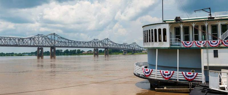 Detail of a steamer boat and the bridge over the Mississippi River near the city of Natchez, Mississippi, USA