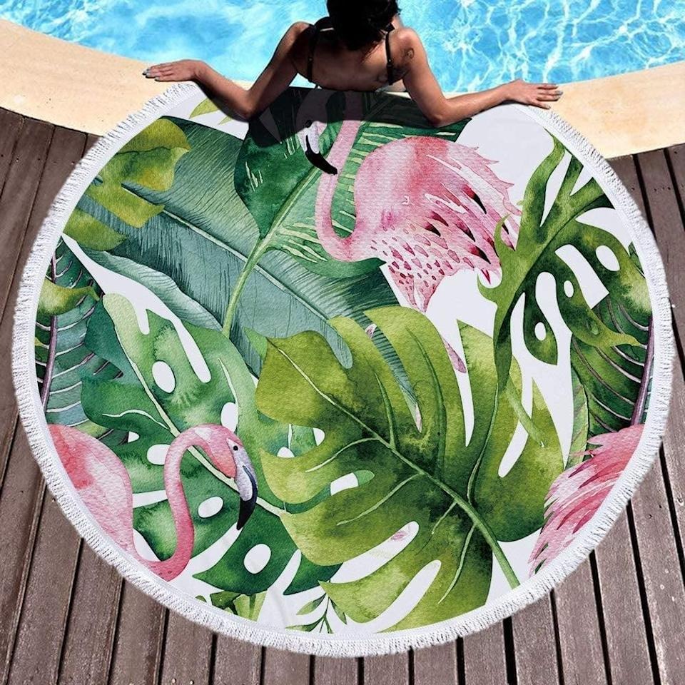 <p>This <span>Oversized Round Beach Towel</span> ($21) is stunning and a must-have for the summer.</p>
