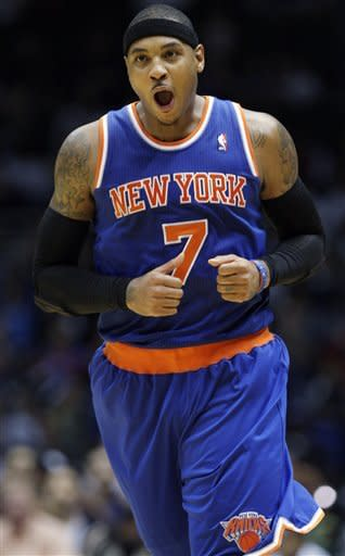 New York Knicks' Carmelo Anthony (7) reacts after scoring during the second half of a preseason NBA basketball game against the Brooklyn Nets, Wednesday, Oct. 24, 2012, in Uniondale, N.Y. (AP Photo/Frank Franklin II)