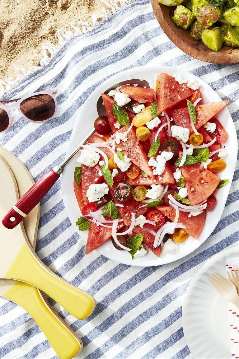"<p>For those craving something a little lighter, this salad's the way to go. It's loaded with fresh watermelon, onion, feta, and refreshing mint.</p><p><strong><a href=""https://www.countryliving.com/food-drinks/a27546614/watermelon-tomato-and-feta-salad-recipe/"" rel=""nofollow noopener"" target=""_blank"" data-ylk=""slk:Get the recipe"" class=""link rapid-noclick-resp"">Get the recipe</a>.</strong></p><p><a class=""link rapid-noclick-resp"" href=""https://www.amazon.com/Yueshico-Stainless-Watermelon-Vegetable-Kitchen/dp/B07MYXN2L9/?tag=syn-yahoo-20&ascsubtag=%5Bartid%7C10050.g.3663%5Bsrc%7Cyahoo-us"" rel=""nofollow noopener"" target=""_blank"" data-ylk=""slk:SHOP WATERMELON CUTTERS"">SHOP WATERMELON CUTTERS</a></p>"
