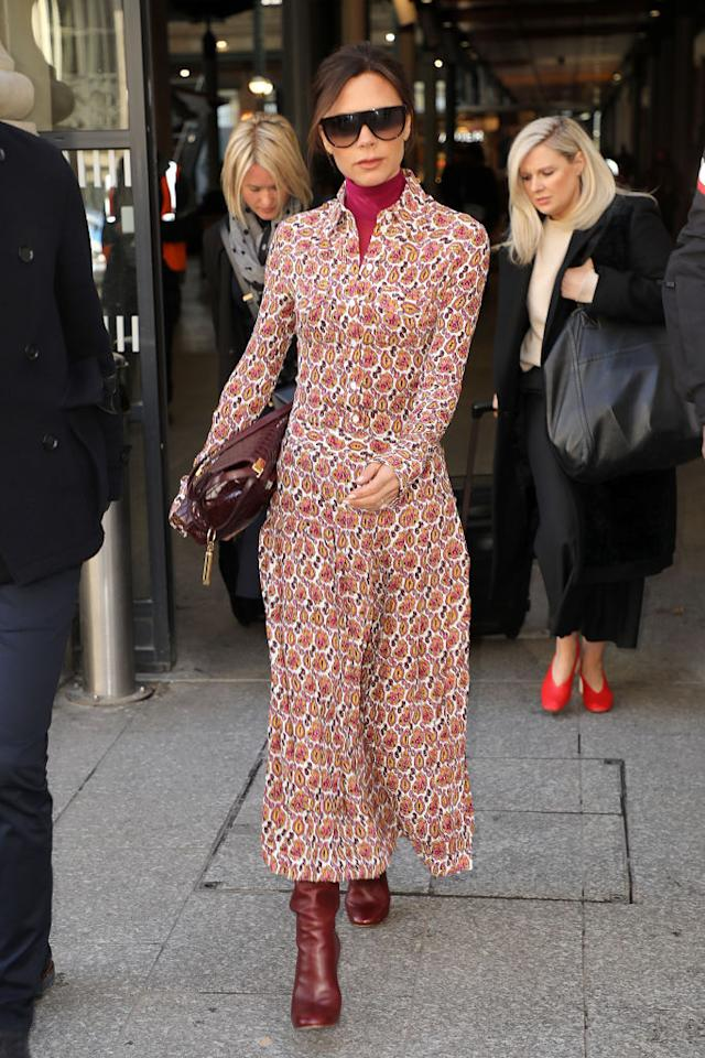 <p>Demonstrating how to work winter hues in the city, the designer stepped out in a burgundy rollneck, oversized shirt dress and co-odordinating boots. <em>[Photo: Getty]</em> </p>