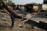 Many homes and stores were destroyed in the market clashes