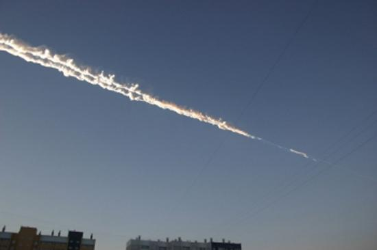 What appears to be a meteor trail over eastern Russian is seen in this image released Feb. 15, 2013, by the Russian Emergency Ministry. The meteor fall included a massive blast, according to Russian reports.